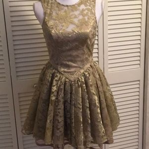 Bebe dress gold  shimmer  size2